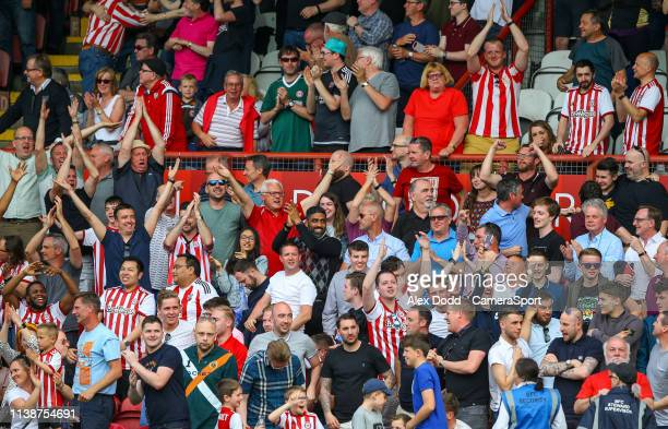 Brentford fans taunt the Leeds United fans as they score a second goal during the Sky Bet Championship match between Brentford and Leeds United at...