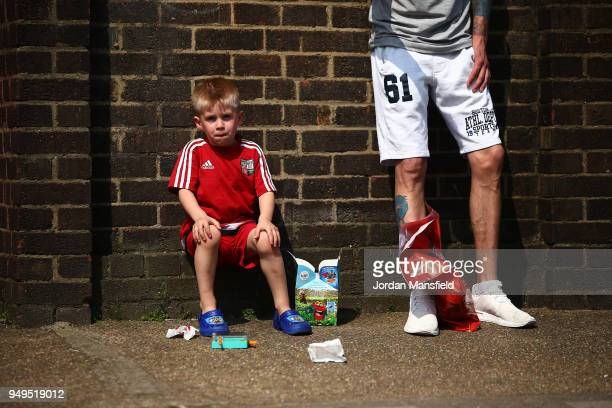 Brentford fans wait outside the ground prior to the Sky Bet Championship match between Brentford and Queens Park Rangers at Griffin Park on April 21...