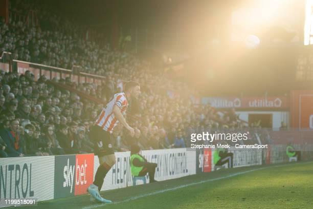 Brentford fans watch their team in action during the Sky Bet Championship match between Brentford and Middlesbrough at Griffin Park on February 8...