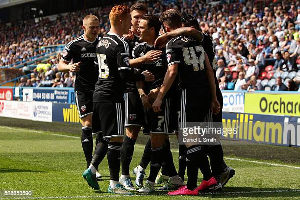 Brentford FC celebrate after Sergi Canos of Brentford FC scores the opening goal during the Sky Bet Championship match between Huddersfield Town and...