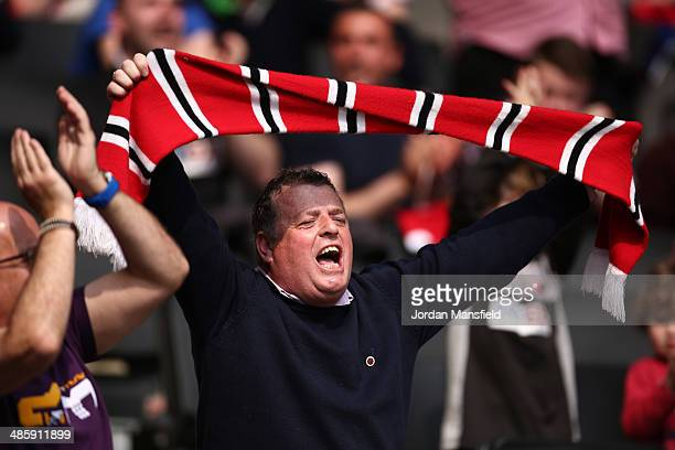 Brentford FC fan cheers during the Sky Bet League One match between MK Dons and Brentford at Stadium mk on April 21 2014 in Milton Keynes England