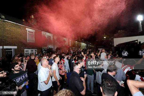 Brentford FC fans celebrate outside the stadium after winning the Sky Bet Championship Play Off Semi-final 2nd Leg match between Brentford and...