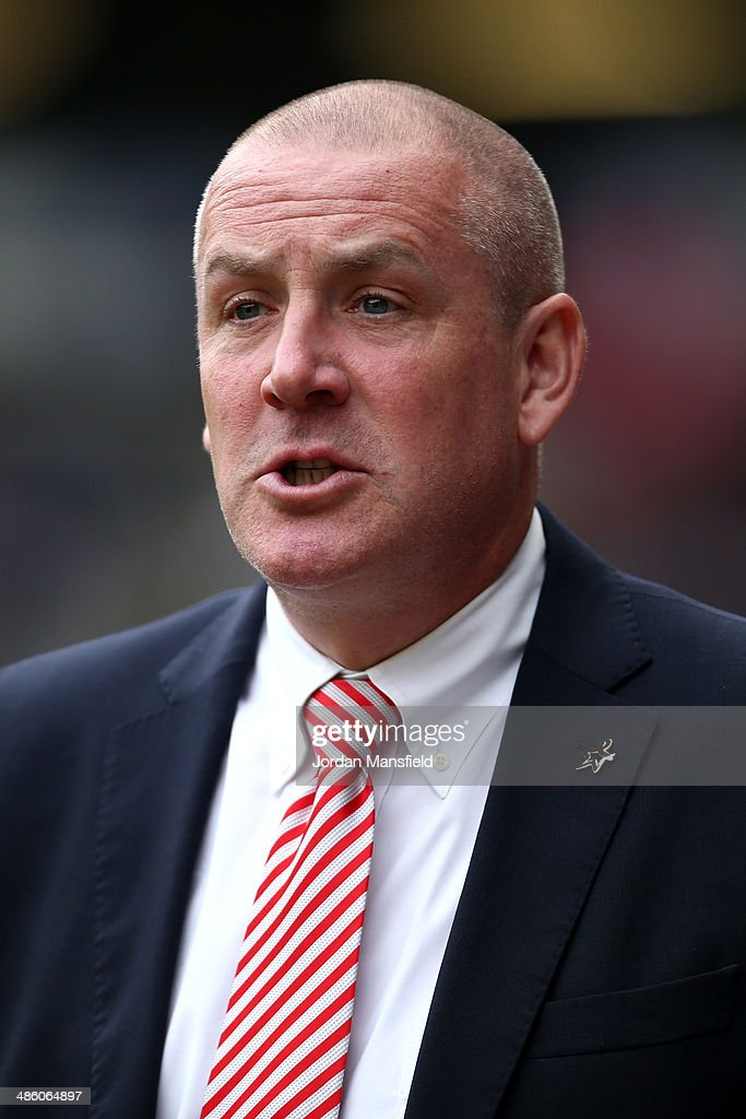 Brentford FC manager Mark Warburton gives orders from the touchline during the Sky Bet League One match between MK Dons and Brentford at Stadium mk on April 21, 2014 in Milton Keynes, England.