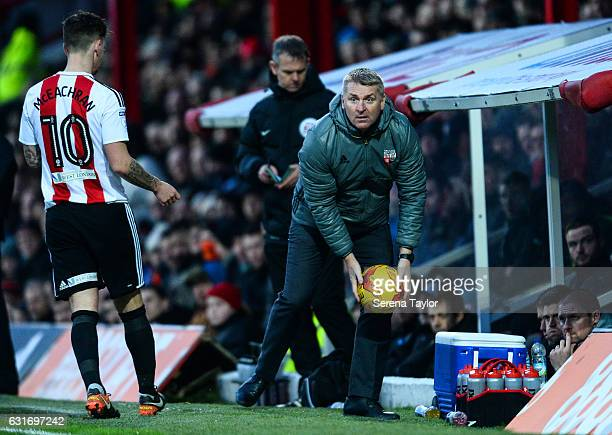 Brentford Football Club Manager Dean Smith looks to throw the ball during the Championship Match between Brentford and Newcastle United at Griffin...