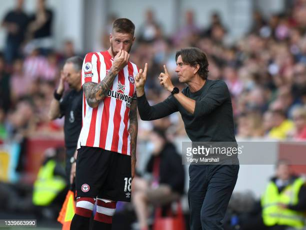Brentford Head Coach Thomas Frank gives instructions to Pontus Jansson of Brentford during the Premier League match between Brentford and Brighton &...