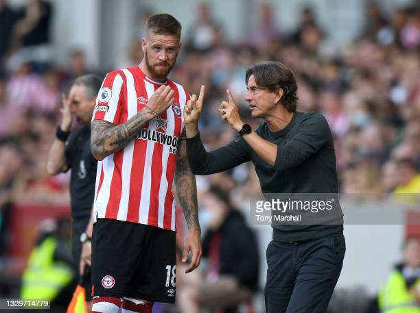 Brentford Head Coach Thomas Frank gives instructions to Pontus Jansson during the Premier League match between Brentford and Brighton & Hove Albion...