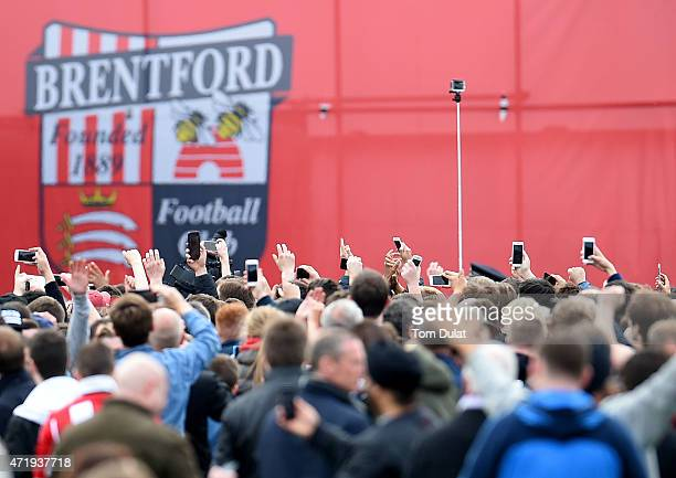 Brentford logo is pictured while the fans use their phones during the Sky Bet Championship match between Brentford and Wigan Athletic at Griffin Park...