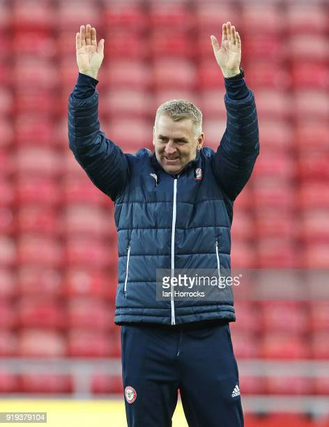 Brentford manager Dean Smith applauds the travelling fans during the Sky Bet Championship match between Sunderland and Brentford at Stadium of Light...