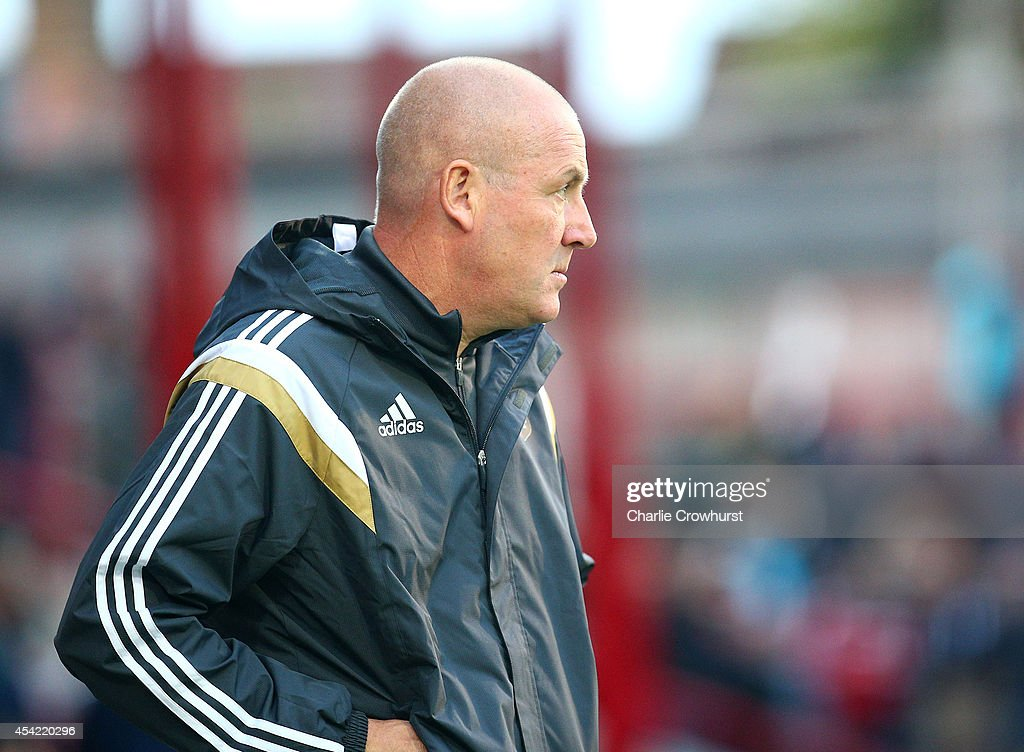 Brentford manager Mark Warburton during the Capital One Cup Second Round match between Brentford and Fulham at Griffin Park on August 26, 2014 in London, England.