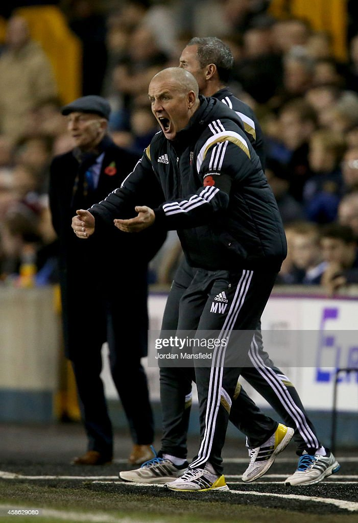 Brentford manager Mark Warburton shouts from the sidelines during the Sky Bet Championship match between Millwall and Brentford at The Den on November 8, 2014 in London, England.