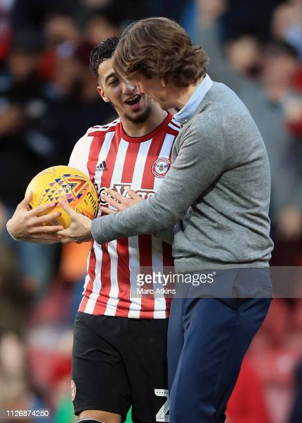 Brentford Manager Thomas Frank and Said Benrahma celebrate the win during the Sky Bet Championship match between Brentford and Hull City at Griffin...