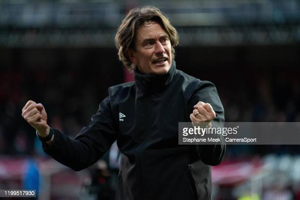 Brentford manager Thomas Frank celebrates with the fans at the final whistle during the Sky Bet Championship match between Brentford and...
