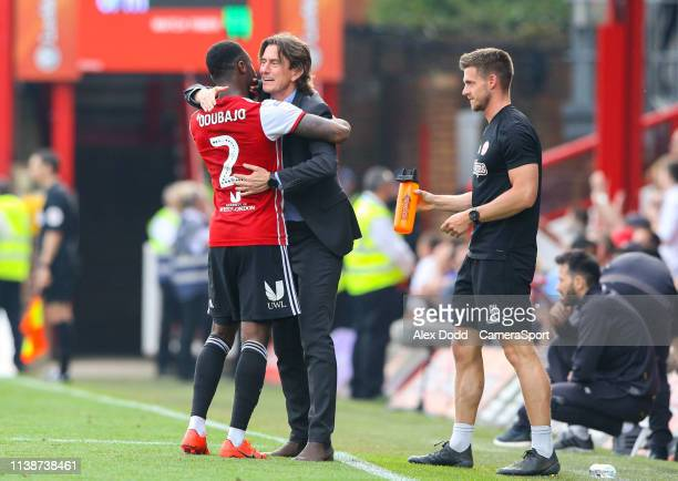 Brentford manager Thomas Frank hugs Moses Odubajo after his side went 10 up during the Sky Bet Championship match between Brentford and Leeds United...