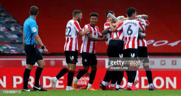 Brentford players celebrate their second goal during the Sky Bet Championship match between Brentford and Charlton Athletic at Griffin Park on July...