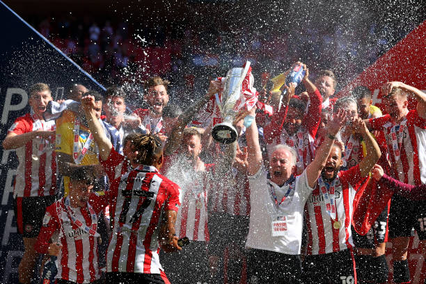 Brentford players celebrate with the Sky Bet Championship Play-off Final trophy after victory in the Sky Bet Championship Play-off Final between...