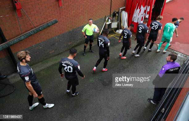 Brentford players enter the pitch during the Sky Bet Championship match between Stoke City and Brentford at Bet365 Stadium on October 24 2020 in...