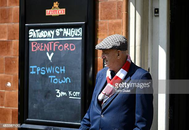 Brentford supporter on his way to the stadium prior to the Sky Bet Championship match between Brentford and Ipswich Town at Griffin Park on August 8...