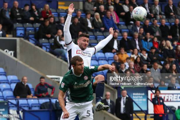 Brentford's Andreas Bjelland and Bolton Wanderers' Gary Madine during the Sky Bet Championship match between Bolton Wanderers and Brentford at Macron...