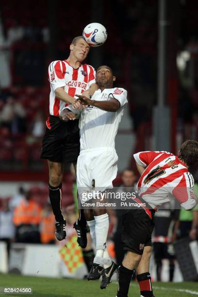 Brentford's Andy Frampton battles with Milton Keynes Dons' Clive Platt during the CocaCola League One match at Griffin Park Brentford Saturday...
