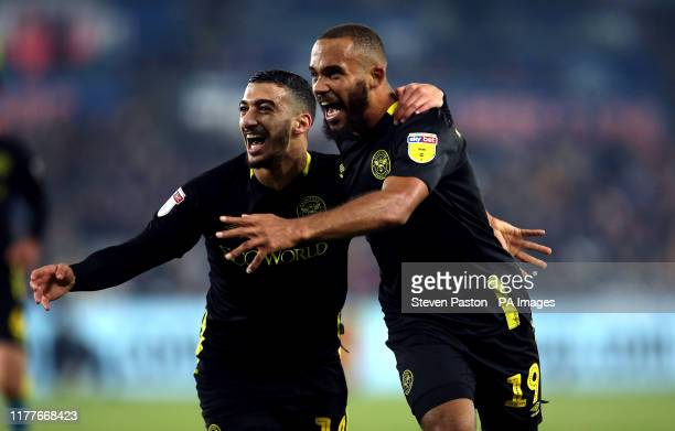 Brentford's Bryan Mbeumo celebrates scoring his side's third goal of the game with Said Benrahma during the Sky Bet Championship match at the Liberty...