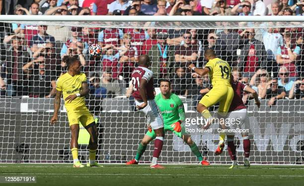 Brentford's Bryan Mbeumo with a header in the first half during the Premier League match between West Ham United and Brentford at London Stadium on...