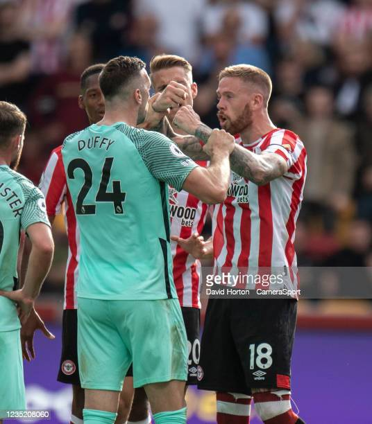 Brentford's captain Pontus Jansson has a disagreement with Brighton & Hove Albion's Shane Duffy during the Premier League match between Brentford and...