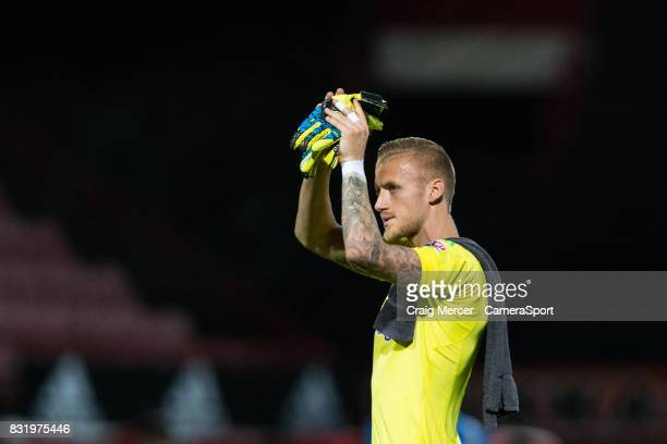 Brentford's Daniel Bentley applauds the fans at the final whistle during the Sky Bet Championship match between Brentford and Bristol City at Griffin...