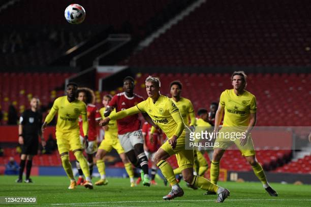 Brentford's Danish midfielder Emiliano Marcondes defends a corner during the English Premier League pre-season friendly football match between...