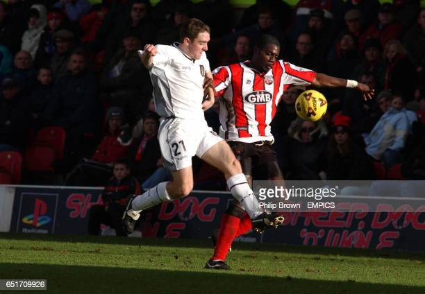 Brentford's Darren Powell and Notts County's Paul Heffernan battle for the ball