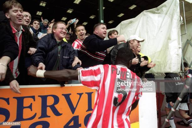 Brentford's Darren Powell celebrates with fans after the match