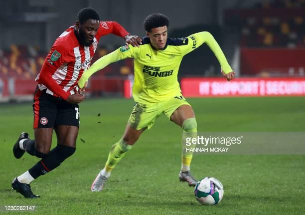 Brentford's English midfielder Josh Dasilva and Newcastle United's English-born Northern Irish defender Jamal Lewis compete for the ball during the...