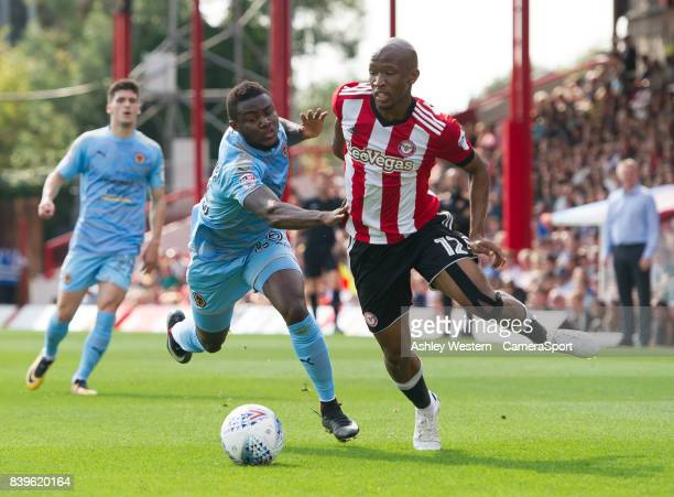 Brentford's Kamohelo Mokotjo holds off the challenge from Wolverhampton Wanderers' Bright Enobakhare during the Sky Bet Championship match between...
