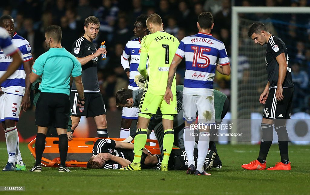Brentford's Lewis MacLeod is stretchered off during the Sky Bet Championship match between Queens Park Rangers and Brentford at Loftus Road on October 28, 2016 in London, England.