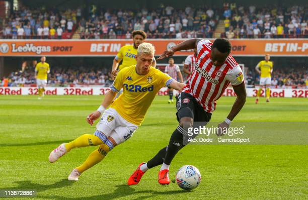 Brentford's Moses Odubajo shields the ball from Leeds United's Ezgjan Alioski during the Sky Bet Championship match between Brentford and Leeds...
