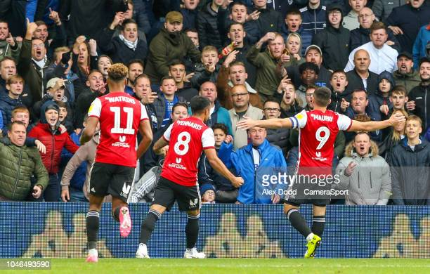 Brentford's Neal Maupay celebrates scoring the opening goal in front of Leeds United fans during the Sky Bet Championship match between Leeds United...
