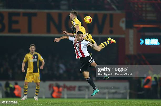 Brentford's Nico Yennaris and Fulham's Tomas Kalas during the Sky Bet Championship match between Brentford and Fulham at Griffin Park on November 4...