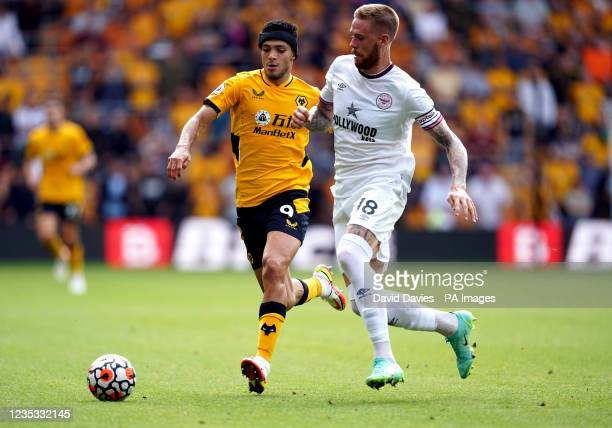 Brentford's Pontus Jansson and Wolverhampton Wanderers' Raul Jimenez battle for the ball during the Premier League match at Molineux Stadium,...