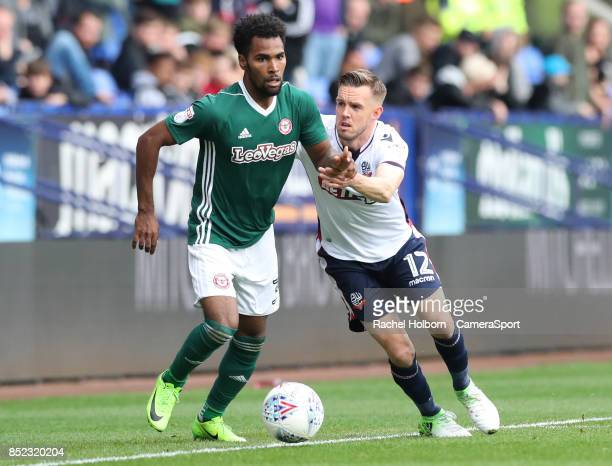 Brentford's Rico Henry and Bolton Wanderers' Craig Noone during the Sky Bet Championship match between Bolton Wanderers and Brentford at Macron...