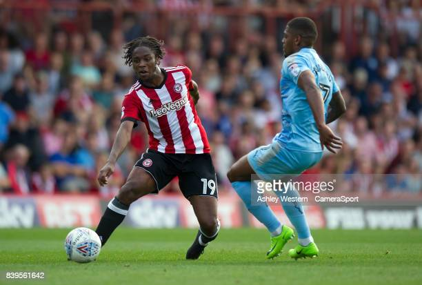 Brentford's Romaine Sawyers battles for possession with Wolverhampton Wanderers' Ivan Cavaleiro during the Sky Bet Championship match between...