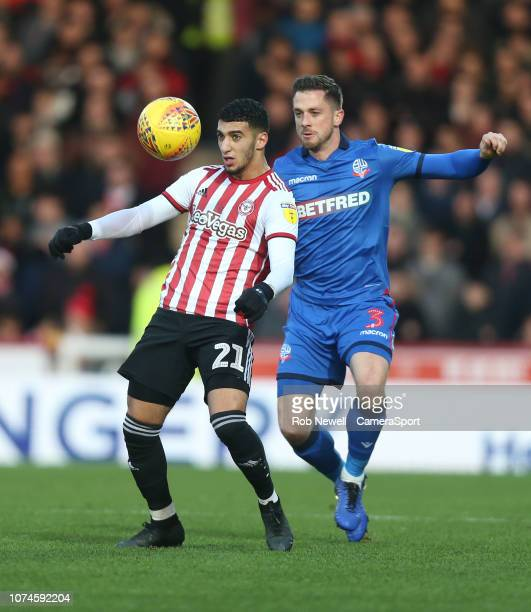 Brentford's Said Benrahma and Bolton Wanderers' Andrew Taylor during the Sky Bet Championship match between Brentford and Bolton Wanderers at Griffin...