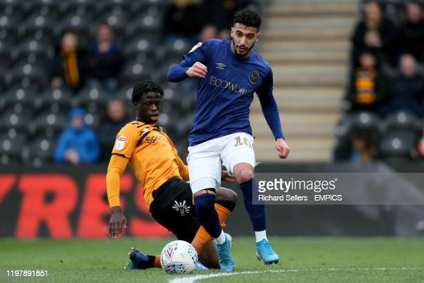 Brentford's Said Benrahma and Hull City's Leonardo da Silva Lopes battle for the ball Hull City v Brentford Sky Bet Championship KCOM Stadium