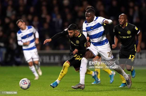 Brentford's Said Benrahma and Queens Park Rangers' Bright OsayiSamuel battle for the ball during the Sky Bet Championship match at Loftus Road London