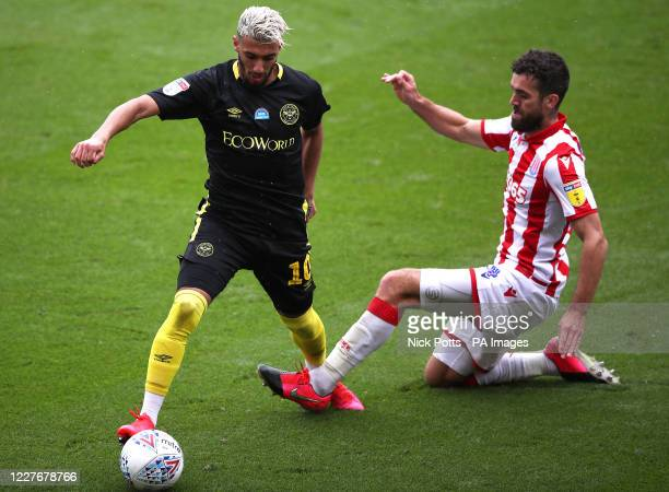 Brentford's Said Benrahma and Stoke City's Tommy Smith battle for the ball during the Sky Bet Championship match at the Bet365 Stadium Stoke
