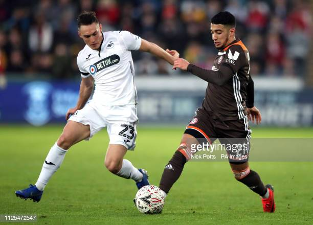 Brentford's Said Benrahma and Swansea City's Connor Roberts battle for the ball during the FA Cup fifth round match at the Liberty Stadium Swansea