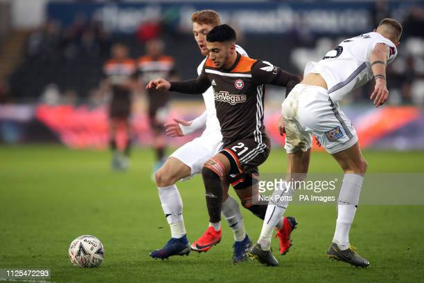 Brentford's Said Benrahma breaks past Swansea City's Mike van der Hoorn and Jay Fulton during the FA Cup fifth round match at the Liberty Stadium...