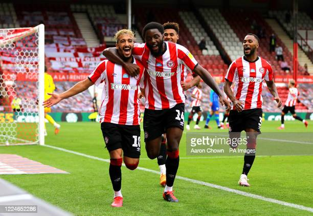 Brentford's Said Benrahma celebrates scoring his side's third goal of the game and his hattrick with teammates Josh Da Silva and Ollie Watkins during...