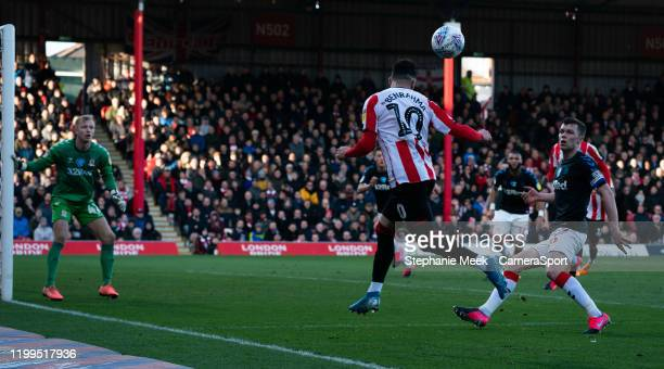 Brentford's Said Benrahma crosses the ball despite the attentions of Middlesbrough's Jonathan Howson during the Sky Bet Championship match between...
