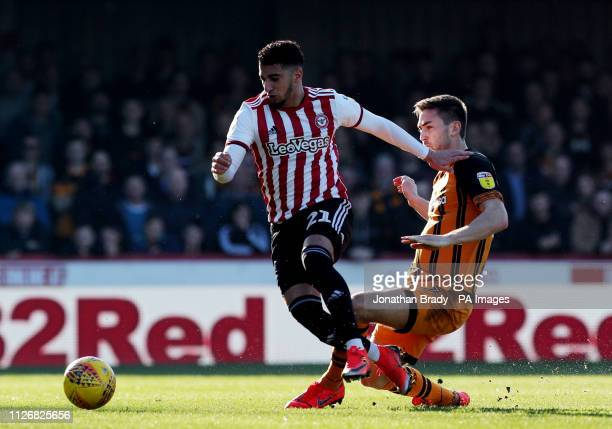 Brentford's Said Benrahma holds off Hull City's Robbie McKenzie during the Sky Bet Championship match at Griffin Park London