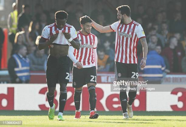Brentford's Said Benrahma is congratulated by team mates Yoann Barbet and Julian Jeanvier after scoring his first goal during the Sky Bet...