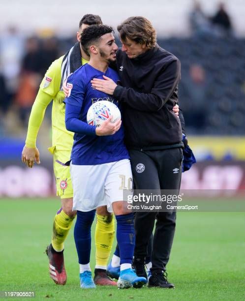Brentford's Said Benrahma left and Brentford manager Thomas Frank following the Sky Bet Championship match between Hull City and Brentford at KCOM...